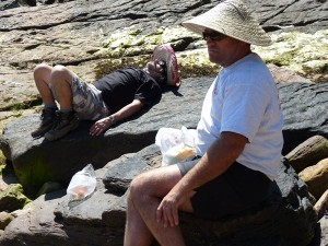 Andy Moss and Dan Glover sunning on the rocks in their ridiculous hats.