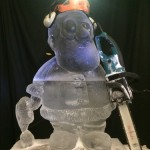 santa ice sculpture with chainsaw and hard hat