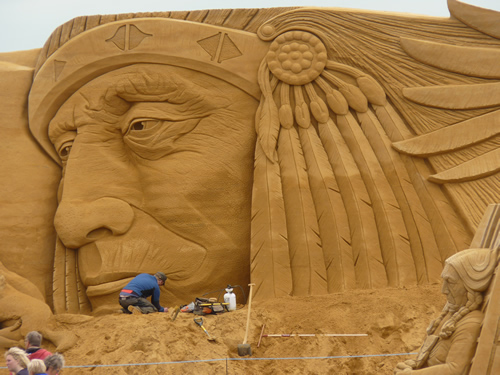 Giant sand sculpture of and Indian face