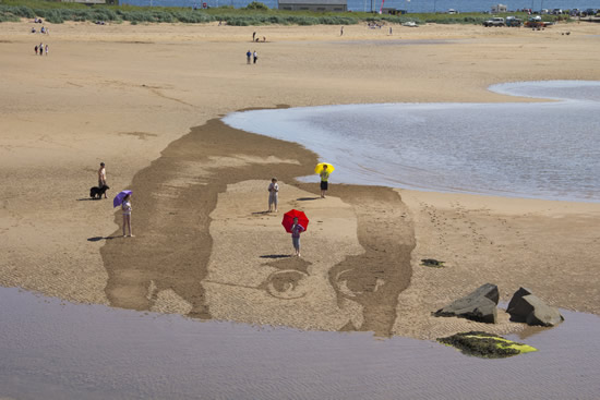 Sea takes sand drawing