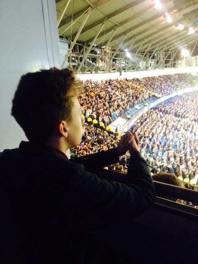 Harry watching the Manchester City Football match