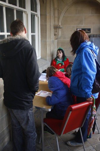 Elf Tiegan making letter to Santa with the children