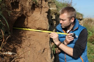 Michael Copleston of the RSPB measuring a cross section of the Sand Martin bank