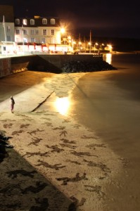 sand drawings on the beach at night