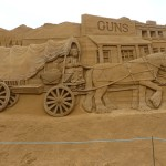 sand sculpture of horse and cart