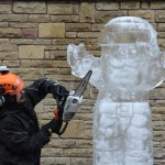 chainsaw carving an ice Santa Claus
