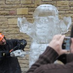 people taking photos of the ice sculpture