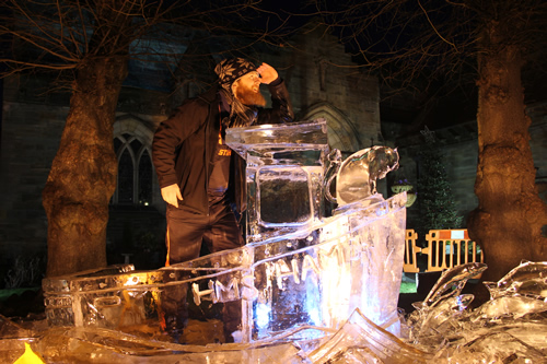 Jamie Wardley on an ice boat sculpture