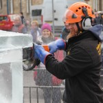 Jamie Wardley carving ice with a chainsaw