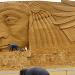 Jamie Wardley making big sand sculpture