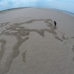 sand drawing of a map of the world