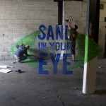 Jamie and Tom working on the Sand In Your Eye logo