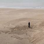 Dan Snow on a giant sand map