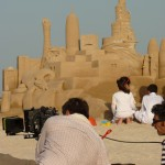 Filming with sand castle