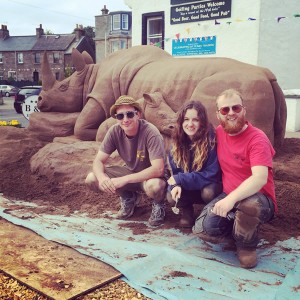 Tom Claire and Jamie with the sand rhino outside the cafe