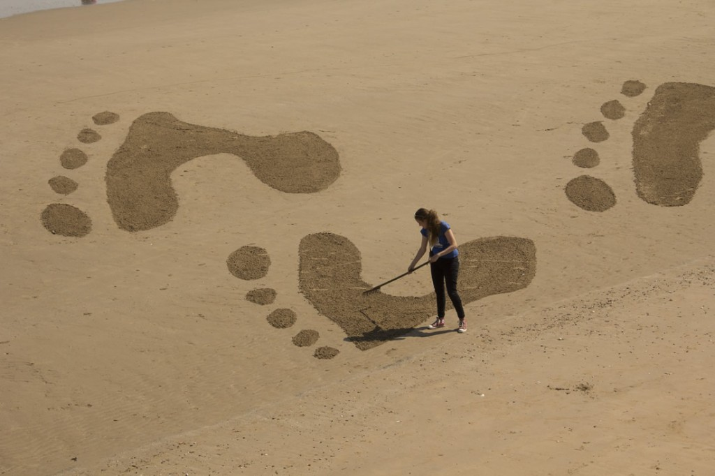 Claire Jamieson drawing in the sand at Filey bay.