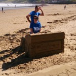 Jo testing the strength of the interactive sand sculpture