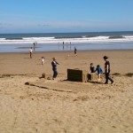 Families enjoying the sand sculpture as we get ready to leave