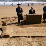 The finished sand sculpture and students alongside