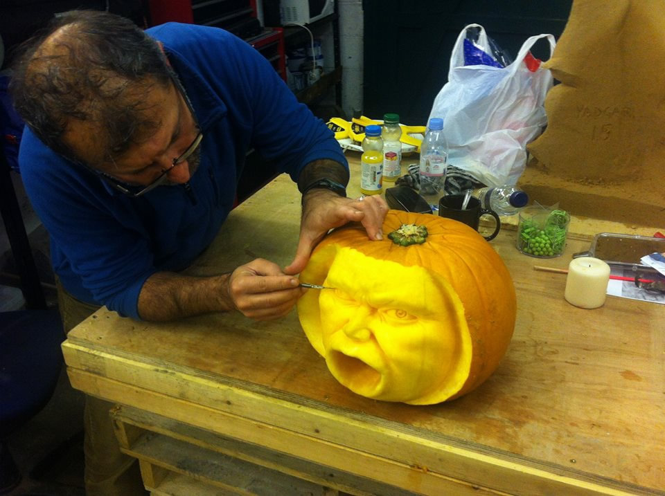 Yad making the finishing touches to one of the pumpkin carvings, just in time for Halloween