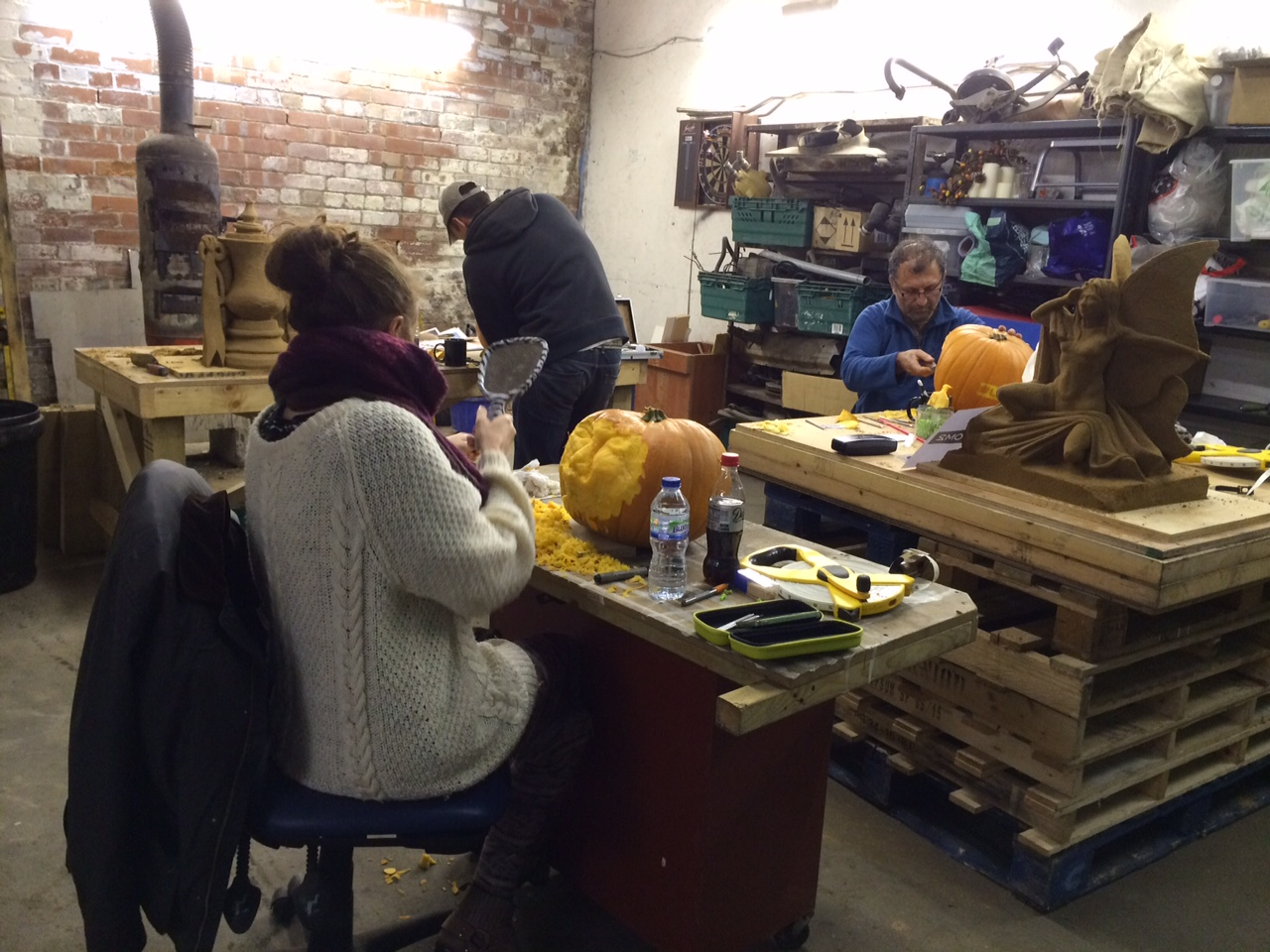 The Sand In Your Eye team busy carving the pumpkins in the workshop