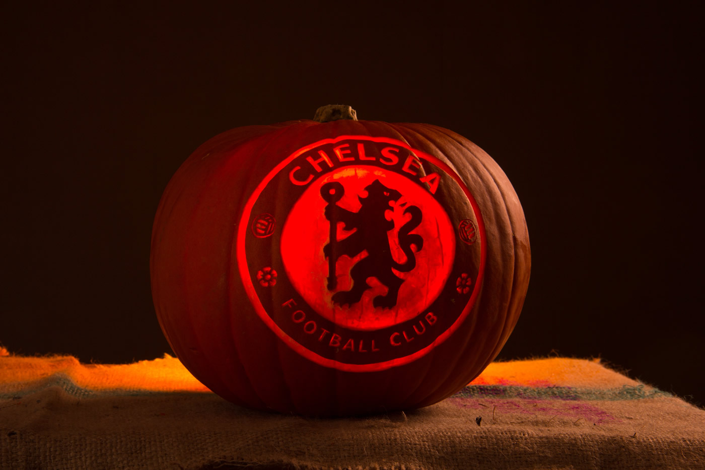 Footballers portraits carved into pumpkins made for