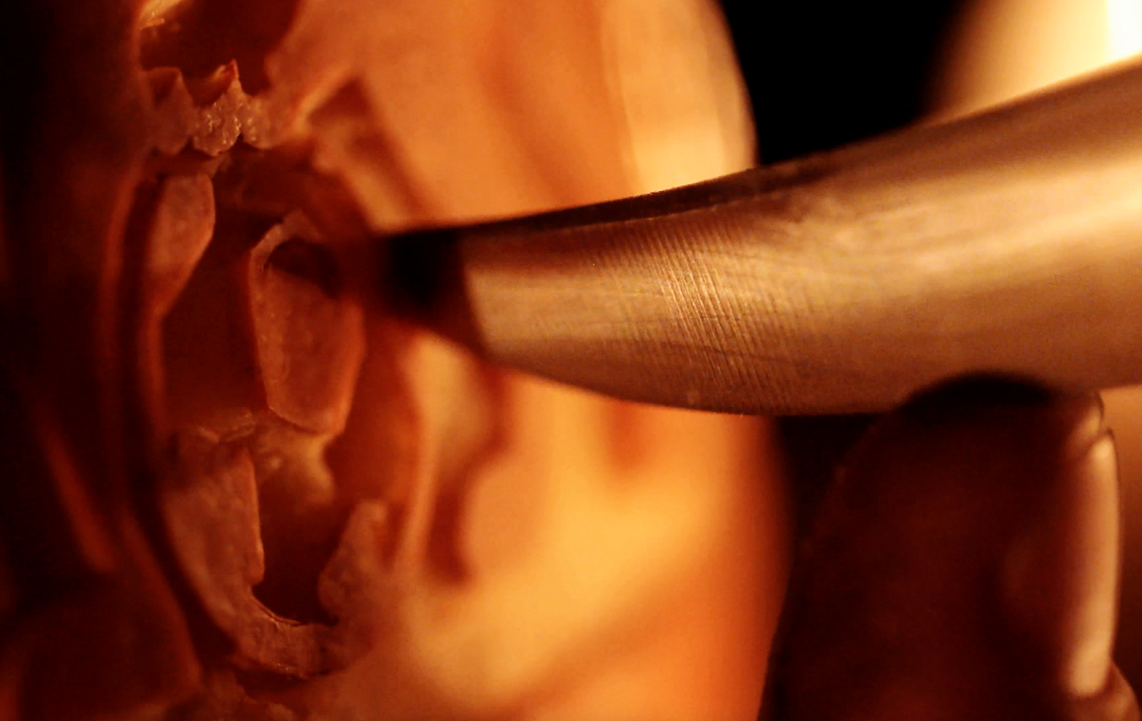 Carving the detail. Courtesy of the Premier League