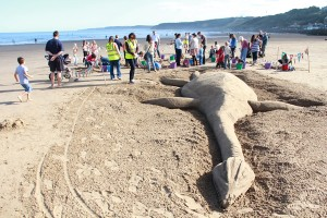 Our beach workshops dinosaur sand sculpture