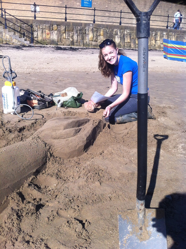 Claire Jamieson working on the sand sculpture
