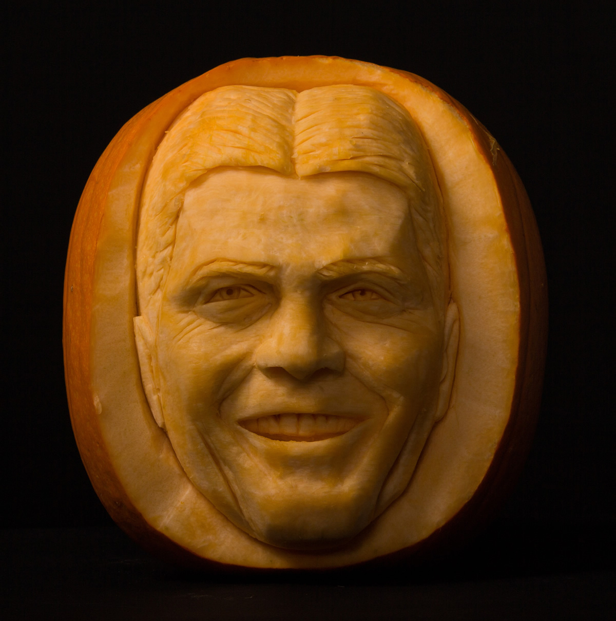 Famous face Simon Cowell carved into a pumpkin