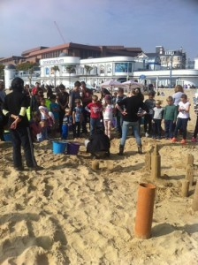 The crowds gathered for the sand sculpture demonstration