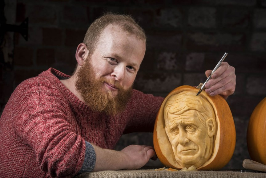 Jamie Wardley, Yorkshire pumpkin carver. Image by REX