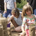 Kids creating sand sculptures with Sand In Your Eye