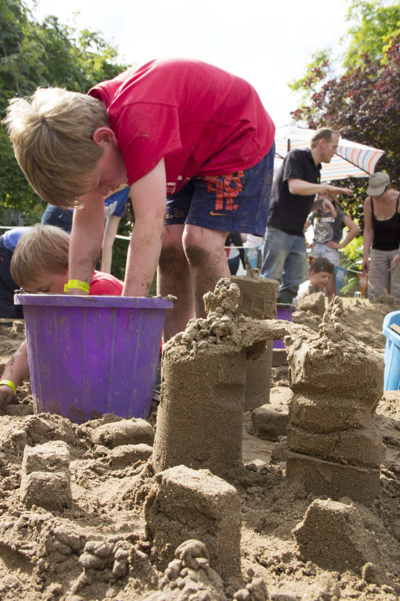 Kids enjoying the sand sculpture workshops at the festival