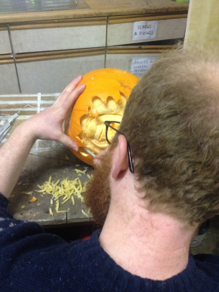 Pumpkin carver beginning the weeks of carving celebrities into pumpkins