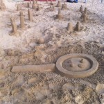 Our pollen magnifying glass sand sculpture