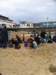 Loads of people getting stuck in at the sand sculpture workshop
