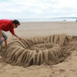 Tom Bolland from Sand In Your Eye, finishing off the sand sculpture