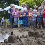 Sand sculpture in the sand pit, families enjoying a fun day