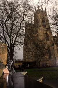 A single ice sculpture of a boy sits outside York Minster at Christmas to raise awareness for the homeless