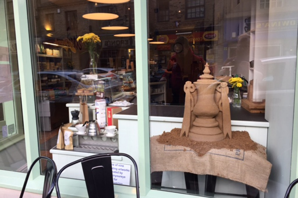 The FA cup sand sculpture sitting in the window of Folks Cafe for the Bantums fans to enjoy