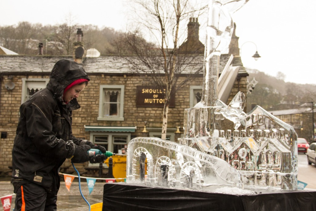 Claire Jamieson ice sculpting in the rain