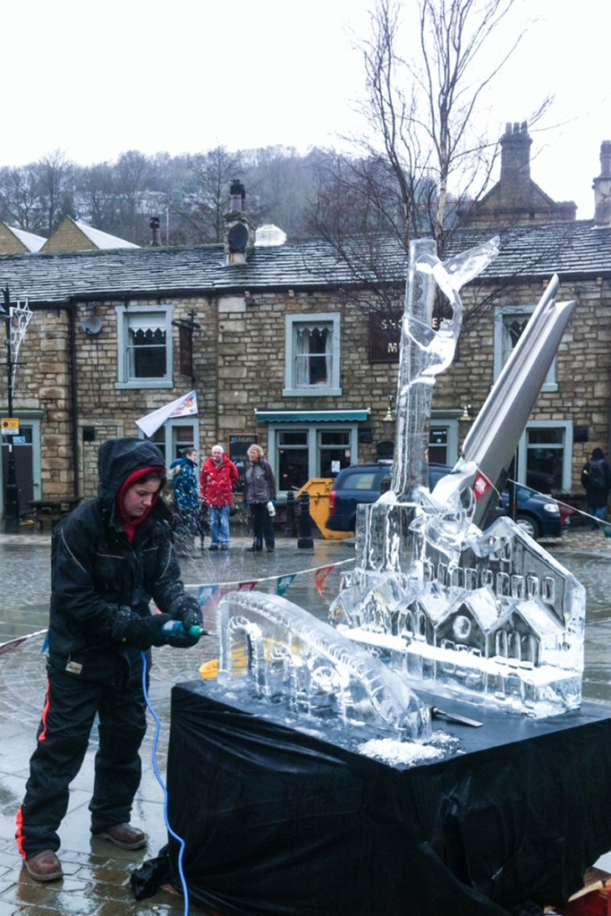 Claire Jamieson carving an ice sculpture live in Hebden Bridge