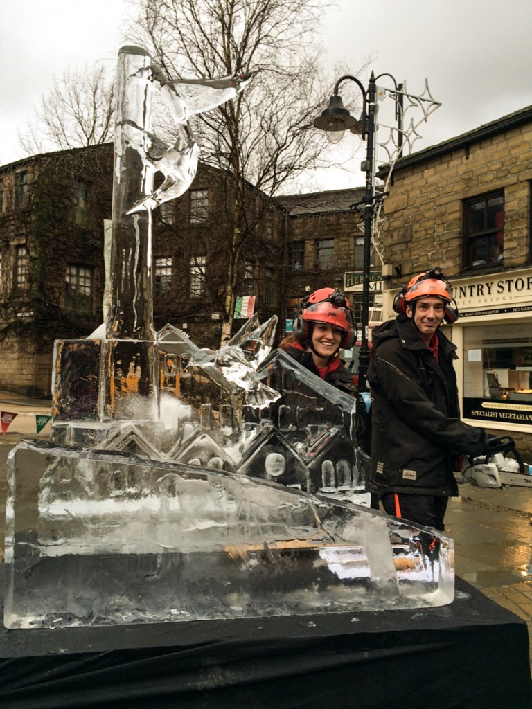 Ice Sculptors Claire Jamieson and Tom Bolland posing with the chainsaws