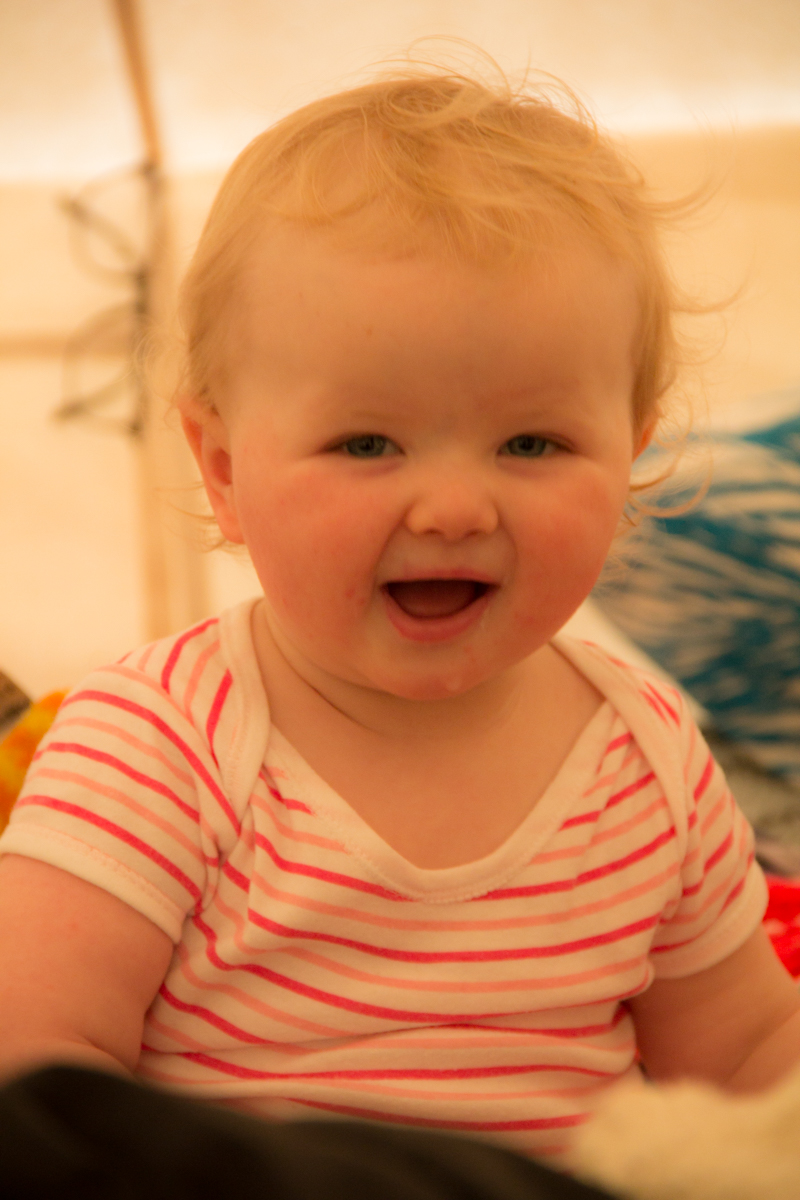 Baby in a bell tent, look at that smile!