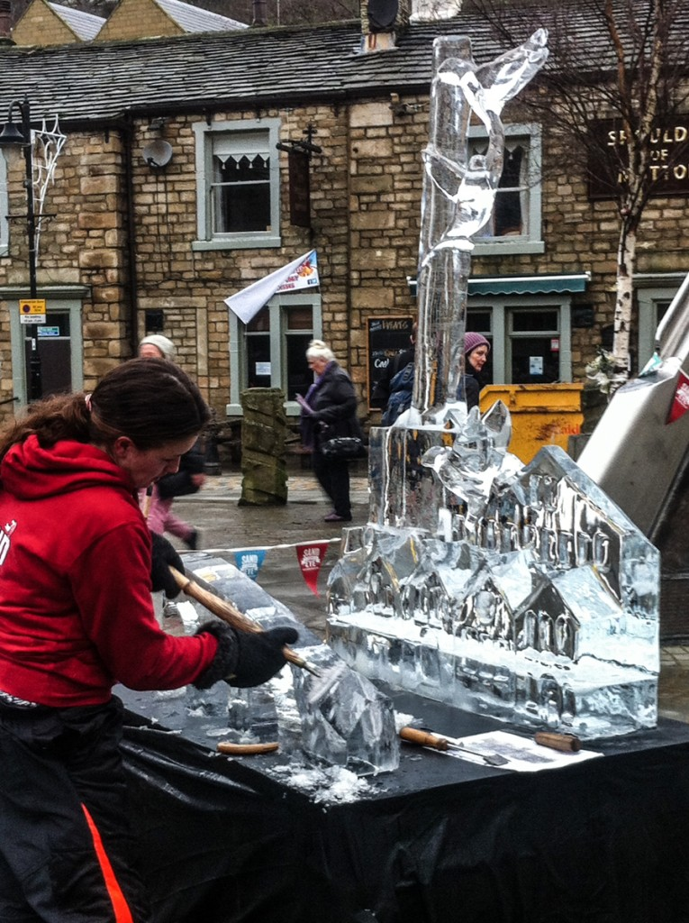 Claire carving her ice sculpture
