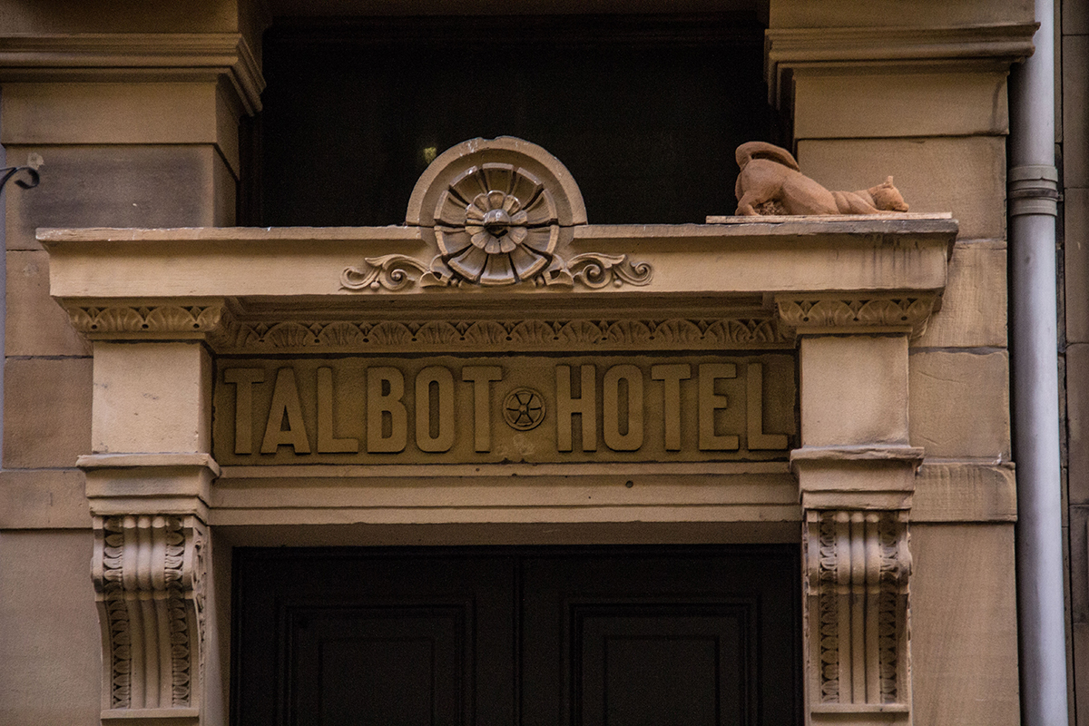 Sand cat sat above a doorway in Bradford