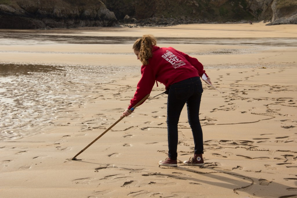 Claire Jamieson making a sand drawing for BBC Springwatch