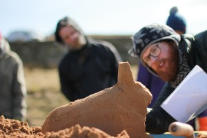 Jamie Wardley tutoring the group in the art of sand sculpture