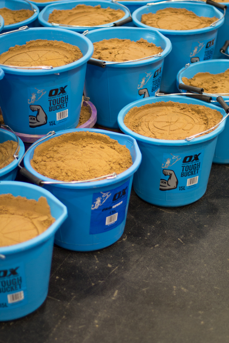 Buckets of sand ready to be used at the trade show event